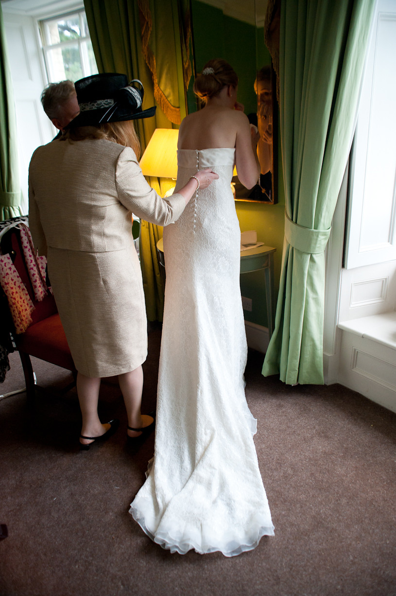 stubton hall wedding bride applying makeup