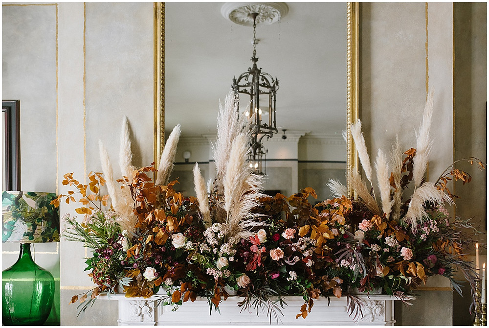 An intimate wedding at luxury wedding venue No131 Cheltenham with Flowers by Passion florals and Pampas Grass decor