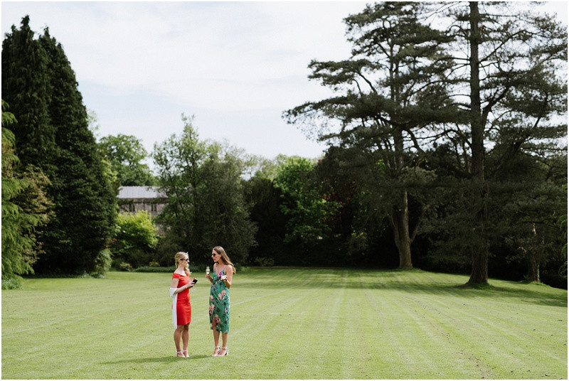 An elegant summer wedding at Pennard house in Somerset guests outside