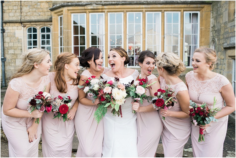 Bridesmaids laughing at Boho Autumn wedding Hilles House Cotswolds
