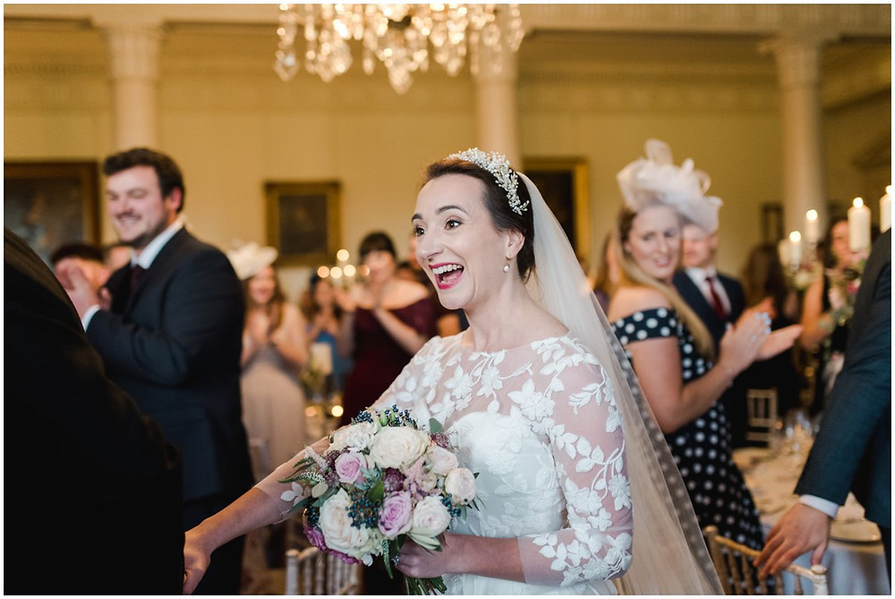 Fine art bride enters ballroom at North Cadbury Court wedding Somerset