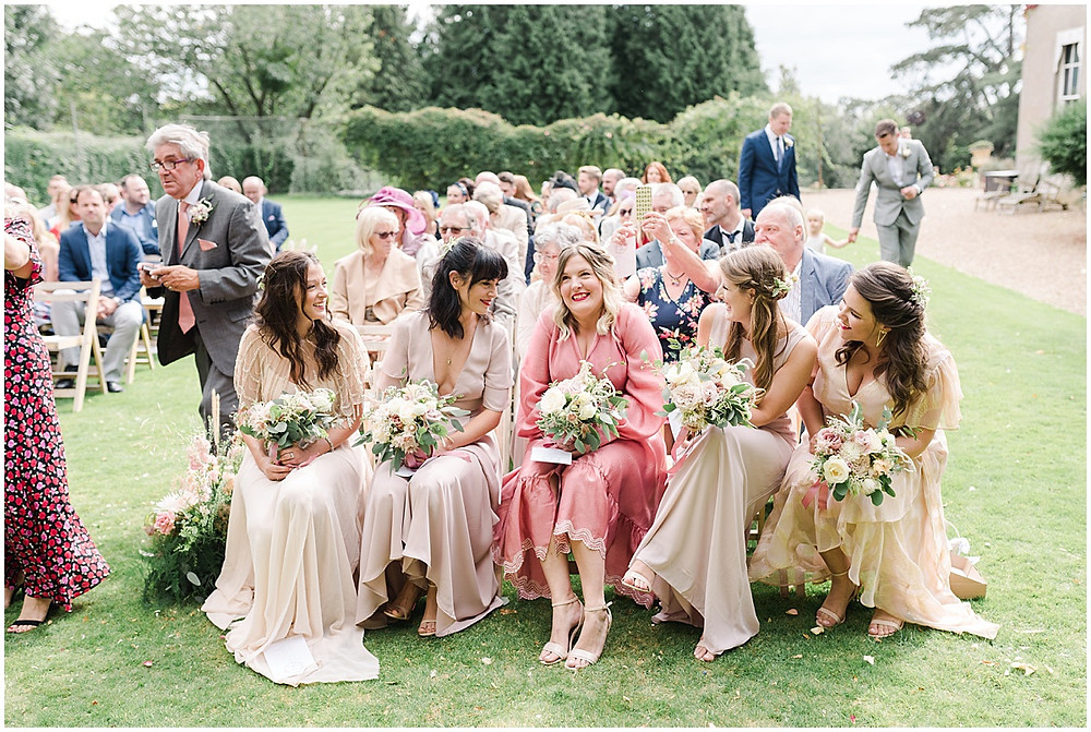 Find lots of luxury wedding inspiration in this dreamy bohemian summer wedding from a Pennard House Wedding Photographer with beautiful bridesmaids in mismatched pink silk dresses