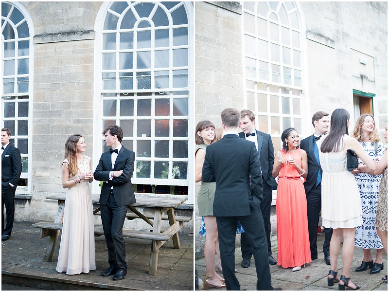 Black tie wedding guests at A military wedding at Malmesbury Abbey with a Charlie Brear dress and flower crowns