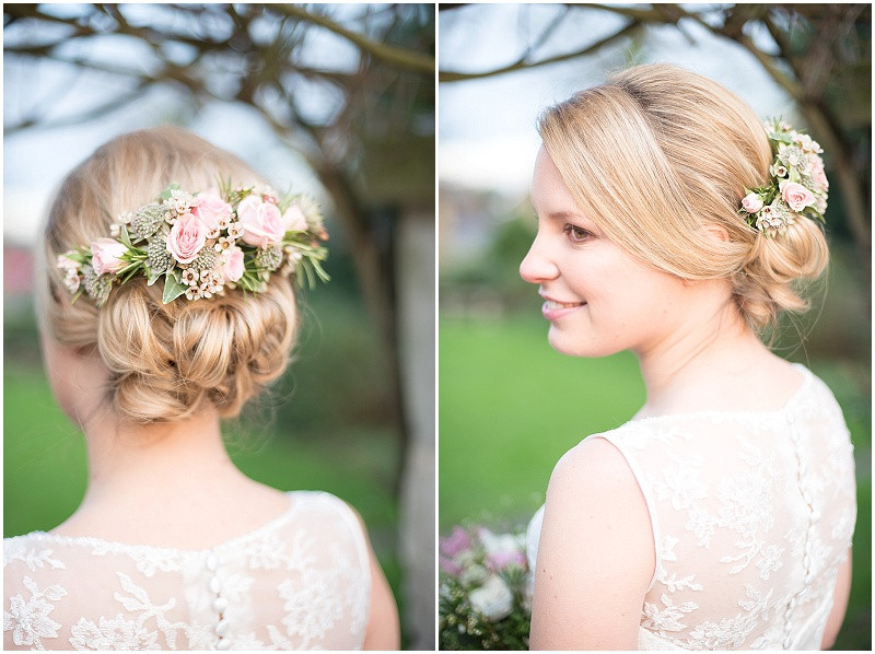 Bride with pink flowers in her hair for a winter wedding at The Moonraker Bradford Upon Avon