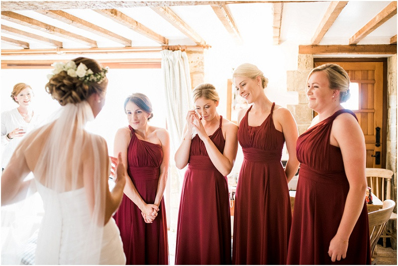 Bridesmaids see bride in Essense of Australia dress at Cotswolds wedding venue Blackwell Grange