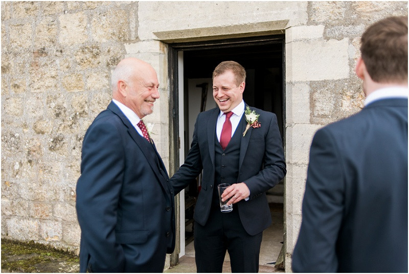 guests laughing at boho Autumn wedding at Hilles house Cotswolds