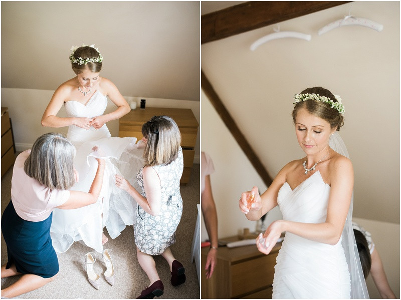 Bride getting ready for Cotswolds wedding at Blackwell Grange in flower crown and Essense of Australia Dress
