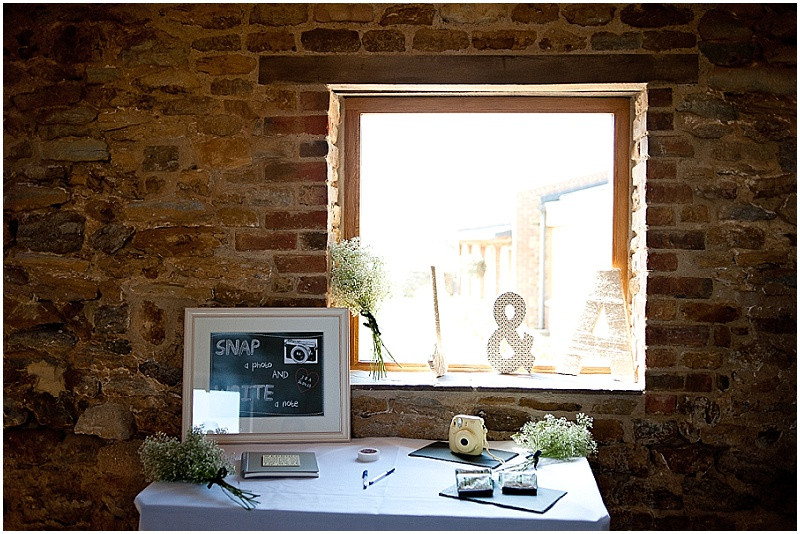 Polaroid guest book for a barn wedding at Dodfrod Manor Northmaptonshire
