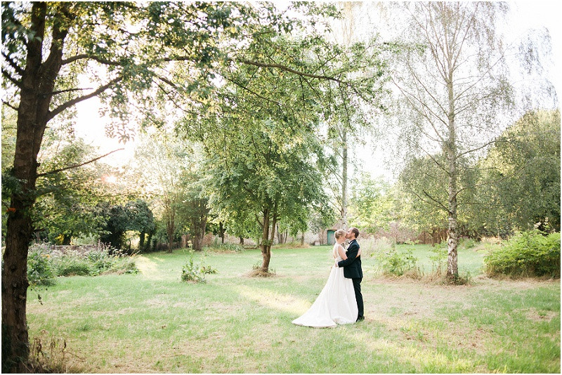 An elegant Cotswolds wedding at Eastington Park with a bride in a Caroline Castigliano wedding dress and groom in black tie tuxedo