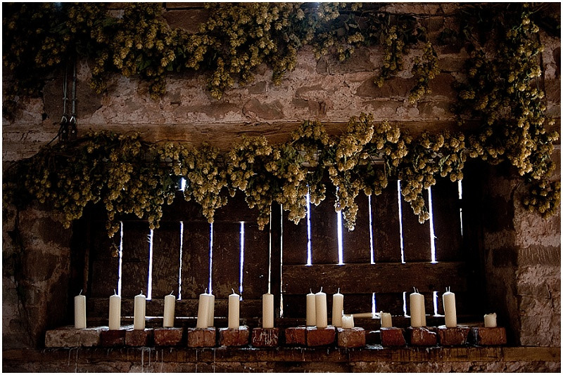 candles and hops at Lyde Court wedding venue Herefordshire