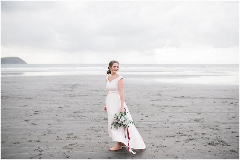 Cotswolds wedding photographer bride in pink Coast skirt and top and groom on beach wedding in Pembrokeshire