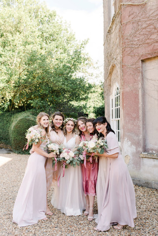 Bridesmaids in mismatched pink dresses a
