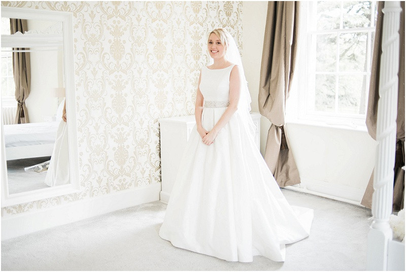 A bride wearing Caroline Castigliano wedding dress at Eastington Park Cotswolds wedding venue