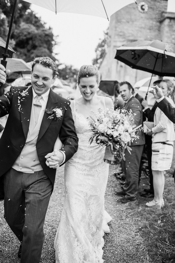 Cotswolds wedding couple leaving church