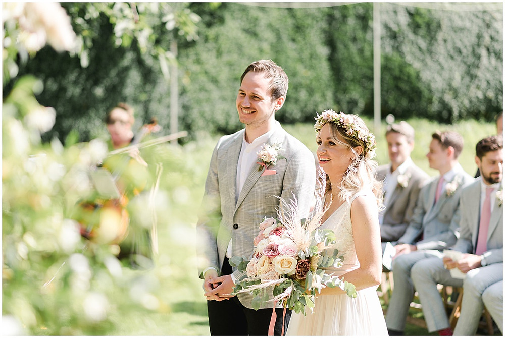 Find lots of luxury wedding inspiration in this dreamy bohemian summer wedding from a Pennard House Wedding Photographer with a boho bride in a flower crown