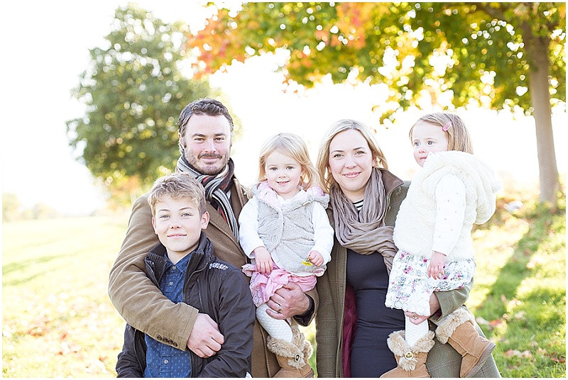 family smiling for an Autumn family photo shoot in Gloucestershire