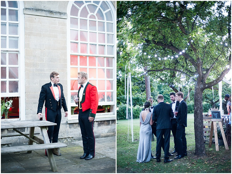 Black tie guests at A military wedding at Malmesbury Abbey with a Charlie Brear dress and flower crowns