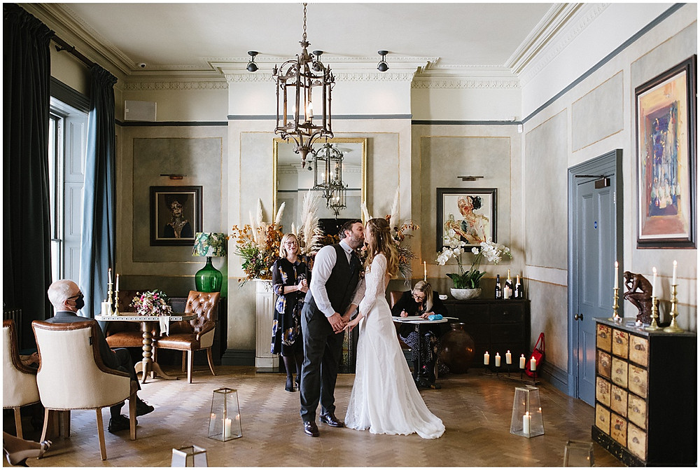 An intimate wedding at luxury wedding venue No131 Cheltenham with pampas grass florals