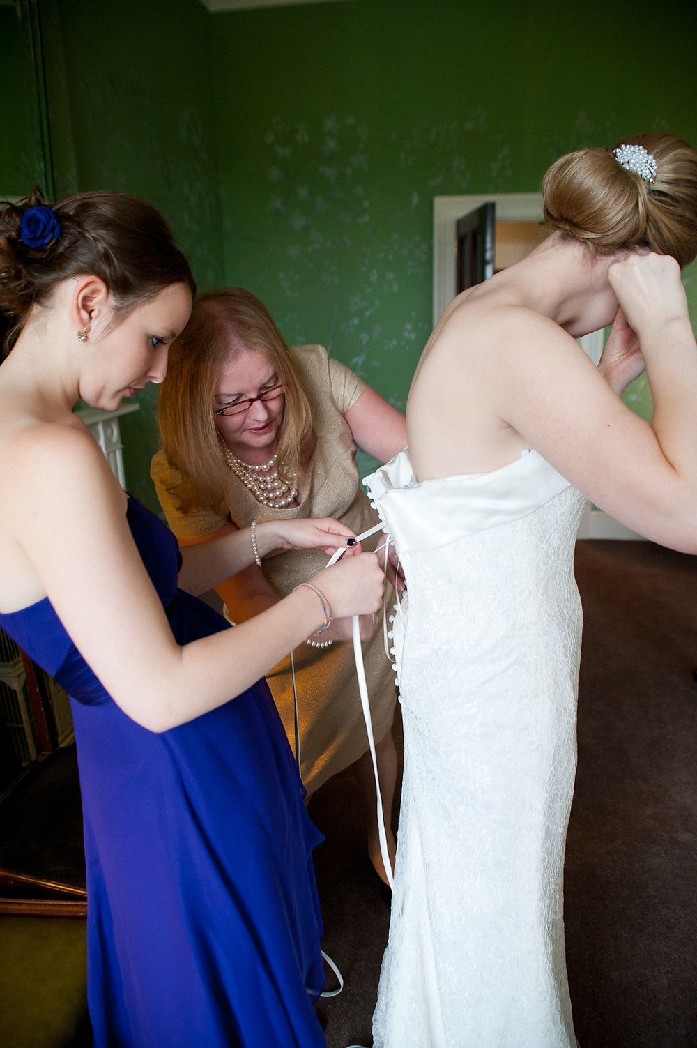 stubton hall wedding putting on wedding dress