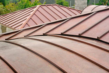 Curved smart tray batten cap roofing
