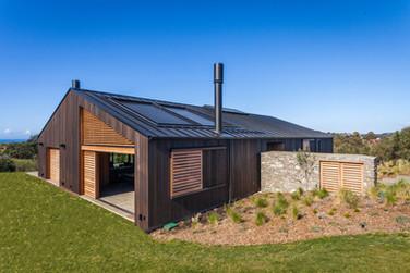 Waiheke Korora Grove House Batten cap standing seam roof