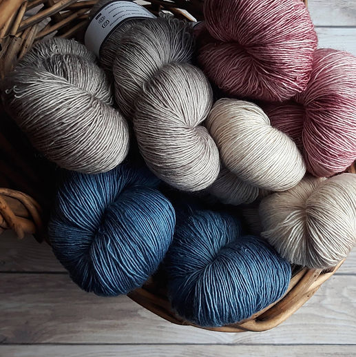 Canva - Assorted-color Yarns on Brown Wi
