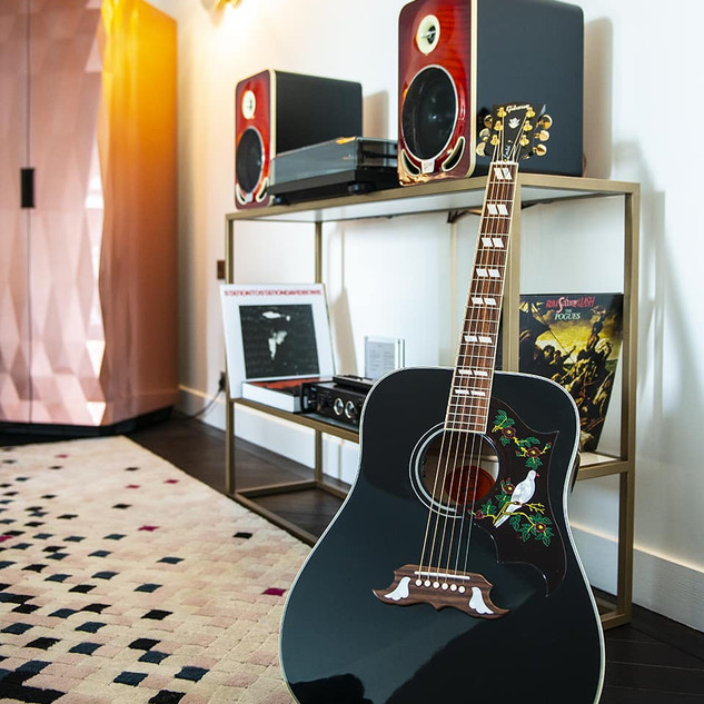 Gibson leaning by speakers.jpg