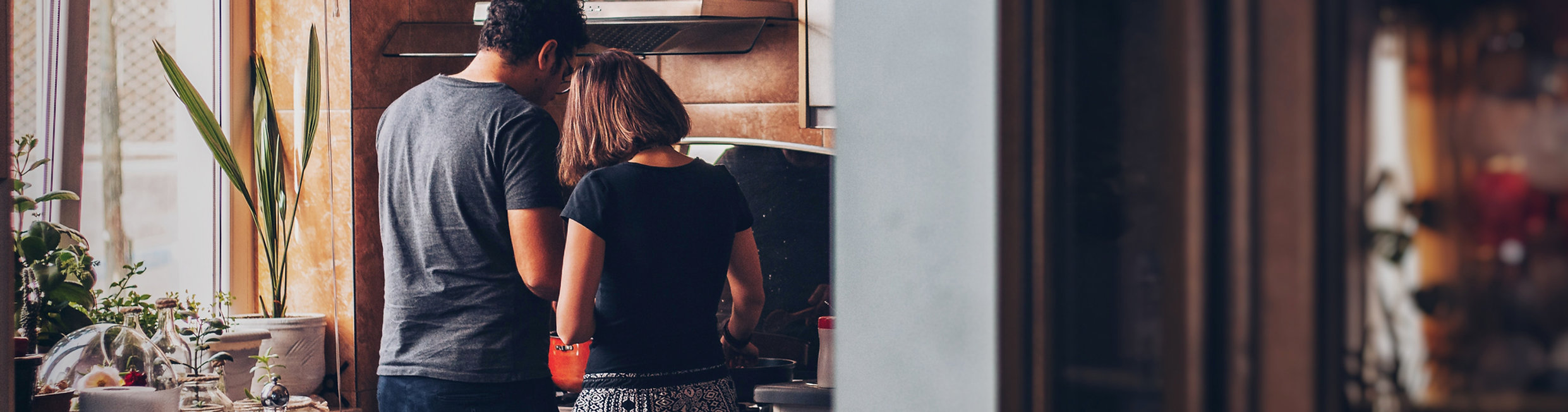 Tenant couple cooking at kitchen stove