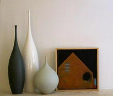 Three boats and a black moon complimented by beautiful ceranmic vessels by Sophie Cook