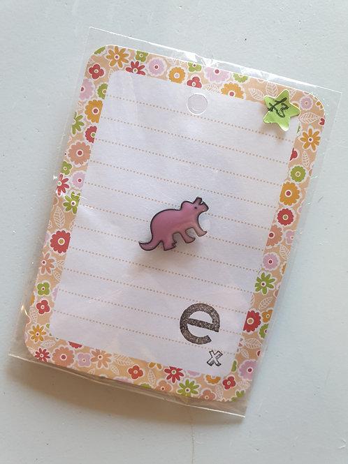Pink triceratops pin badge