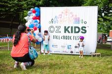 OZ Kids - kids in front of banner.jpg