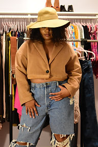 ReneA P. is modeling her upcycled cropped wool coat with baggy jeans. Click to shop more upcycles.