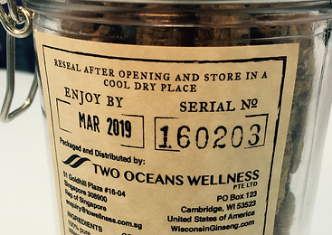 Photograph of a Grand Crû Wisconsin Ginseng product showing an unique serial number on its reverse label.