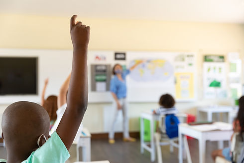 students-raising-hands-in-class-at-school-CCBQDMT.jpg