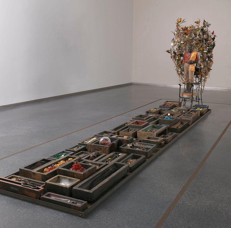 Mixed media including found and fabricated objects.