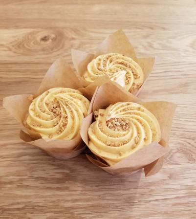 Vanilla cupcake with pumpkin cream cheese frosting