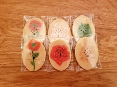 Stamped sugar cookies colored by hand