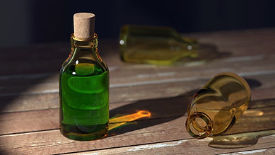 An old fashioned green medicine bottle stands on a wooden table