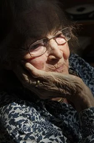 Bereaved elderly lady.webp