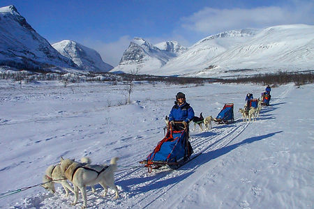 Husky team in the Swedish mountain on a multyday tour around kebnekaise in Swedish Lapland