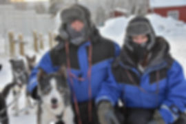 Guests and alaskan husky Dante at Laplandhusky in Swedish Lapland