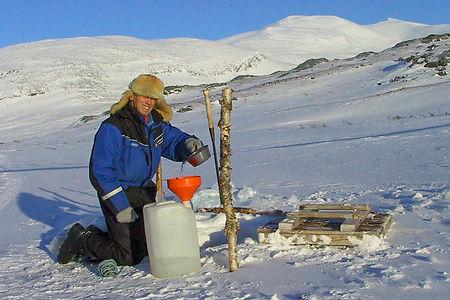 filling water on a husky safari tour in the Swedish mountain in Swedish Lapland