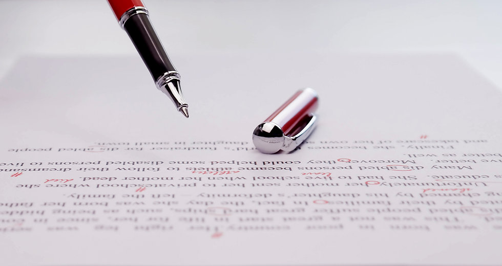 proofreading paper on white table in off