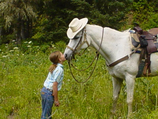 Shadow loved to flirt with the girls and steal a kiss when he could. He knew cowgirls couldn't resist a cowboy in a white hat. My granddaughter, Rae Fullmer.