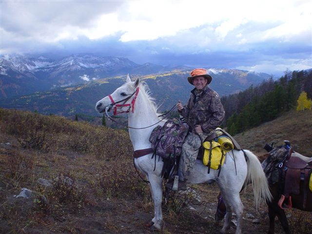 Shadow loved to climb mountains during hunting season. We are at the top of Squaw Creek, with Middle Ridge and Elk Mountain in the background across Greys River far below.