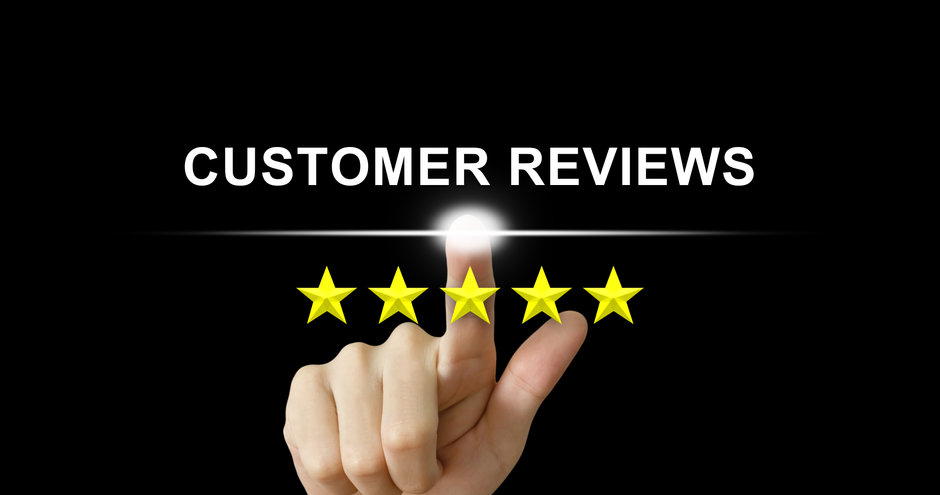 business hand clicking customer reviews