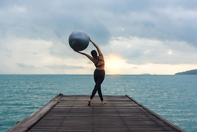 Yoga ball, pilates ball young woman in t