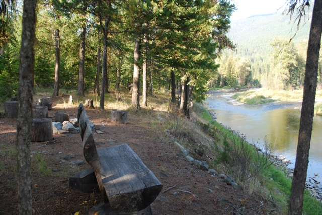 Enjoy the view from the fire pit and seating close to the River Cabin.