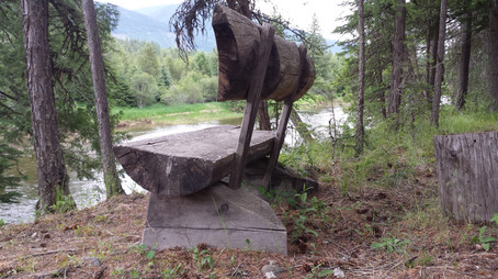 The rustic bench at the River Cabin