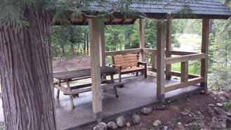 A view of the Moyie River through the shelter at Cedar Grove Camp
